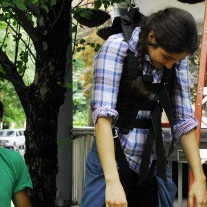 Director Laura Thies testing the harness with help from a grip